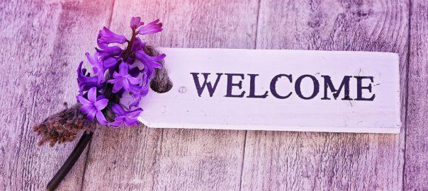 Willkommen mit Blume